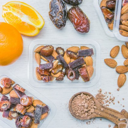 image of cacao orange fruit pieces with dates and raw almonds